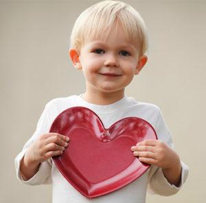 Boy holding a heart